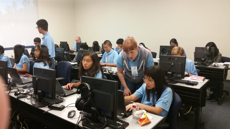 Lysa-Myers_ESET-Secruity-Reseracher-assists-student-at-the-Securing-Our-eCity-Cyber-Bootcamp-768x432